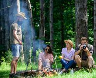 Camping and hiking. Company friends relaxing and having snack picnic nature background. Company hikers relaxing at. Picnic forest background. Spend great time royalty free stock photo