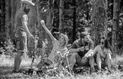 Camping and hiking. Company friends relaxing and having snack picnic nature background. Great weekend in nature. Company. Hikers relaxing at picnic forest royalty free stock photo