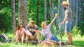 Camping and hiking. Company friends relaxing and having snack picnic nature background. Great weekend in nature. Halt stock images