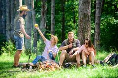 Camping and hiking. Company friends relaxing and having snack picnic nature background. Relax in nature environment. Halt for snack during hiking. Company stock image