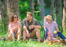 Camping and hiking. Halt for snack during hiking. Company friends relaxing and having snack picnic nature background. Company hikers relaxing at picnic forest royalty free stock photo