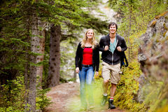 Camping Hiking Man and Woman. A happy man and woman hiking on a camping trip royalty free stock photography