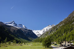 Camping in the hills. A beautiful camping between the peak of the mountains,Valsavaranche, Aosta, Italy stock photos