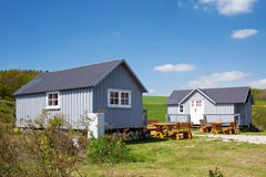 Camping Houses And Benched On Grassy Field Royalty Free Stock Image