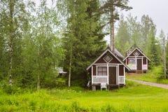 Camping houses under rain. Palvaanjarven Campsite, Lappeenranta, Royalty Free Stock Photos