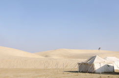 Camping huts and sand dunes Stock Photo