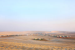 Camping huts and sand dunes of Qatar Royalty Free Stock Images