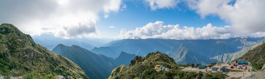 Camping on the Inca Trail. This Campsite from the third day of the Inca Trail Trek sits on top of a mountain range and faces towards Machu Picchu Mountain Stock Image