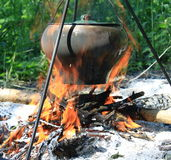 Camping kettle over burning campfire Royalty Free Stock Images