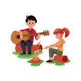 Camping kids - playing guitar and frying marshmallow on fire Royalty Free Stock Photo