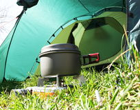 Camping kitchenware. In grass for tent royalty free stock photo