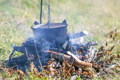 Camping kitchenware - pot on the fire at an outdoor campsite.  stock photo