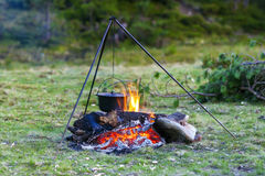 Camping kitchenware - pot on the fire at an outdoor campsite.  stock image