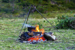 Camping kitchenware - pot on the fire at an outdoor campsite.  stock images