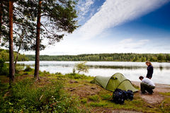 Camping by Lake. A couple camping on a lake landscape royalty free stock photos