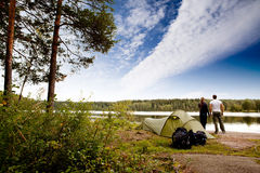 Camping by Lake. A couple camping on a lake landscape royalty free stock photography