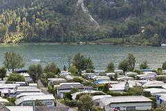 Camping on lake shore in Austrian Alps. Trailers camping on Mondsee lake shore in Austrian Alps stock images