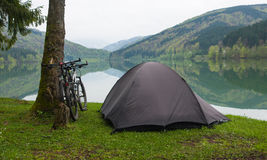 Camping by a lake stock images