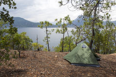 Camping by a Lake. A tent set up beside the beautiful Lugu Lake in Yunnan province, China Royalty Free Stock Image