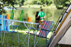Camping. Landscape with sunbeds and tent in foreground stock images