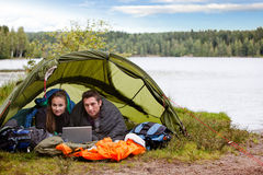 Camping with Laptop by Lake Royalty Free Stock Photos