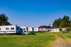 Camping life with caravans in nature park Stock Photos