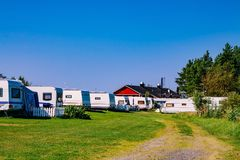 Camping life with caravans in nature park Stock Photo