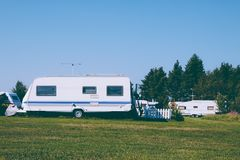 Camping life with caravans in nature park Royalty Free Stock Image