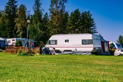 Camping life with caravans in nature park Royalty Free Stock Images