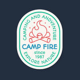Camping logo consisting of camp fire and sign explore nature. Camping logo line color style consisting of camp fire and sign explore nature for kids camp Royalty Free Stock Image