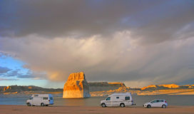 Camping - Lone Rock Beach - Lake Powell, Arizona. Several RVs camping on the beach near Lone Rock ( a large sandstone monolith) on Lake Powell a few miles stock photography