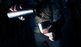 Camping man with thermos stock image