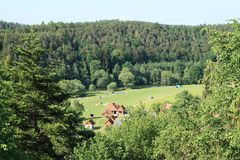 Camping on meadow among forests. Camp above ruin of castle Girls Stone, Czech Republic stock photos