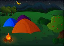 Camping in the meadow at night Stock Photo