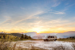 Camping Motor Home parked outdoor in the mountains. Small Motor Home parked outdoors in the mountains during sunset in autumn Stock Photography