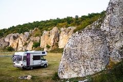 Camping with motorhome. In mountains Stock Images