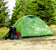 Camping.Mountain Boots, Tent and Backpack Stock Photography