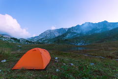 Camping in mountain lake Stock Photos