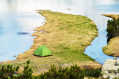 Camping on a Mountain Lake Stock Photography
