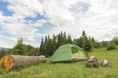 Camping in a mountainous area with cooking equipment. Royalty Free Stock Photography