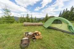 Camping in a mountainous area with cooking equipment. Stock Photo