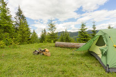Camping in a mountainous area with cooking equipment. Royalty Free Stock Photo