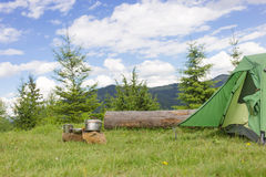 Camping in a mountainous area with cooking equipment. Stock Photography