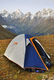 Camping in the mountains. Tent with mountains in the background. Taken in Svaneti area, Georgia Royalty Free Stock Images