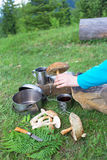 Camping in the mountains and cooking food from mushrooms. Hiking in the mountains in the summer with the collection of mushrooms Royalty Free Stock Photos
