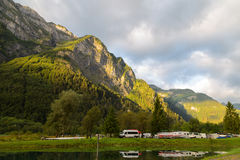 Camping in the mountains. Camping in the  mountains on the lake. Swiss Alps, sunlit Royalty Free Stock Images