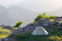 Camping in the mountains. Morning landscape with a tent. Camping in the Spring Mountains Stock Photos