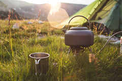 Camping in the mountains at morning. Stock Photo