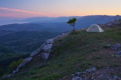 Camping in the mountains. Night landscape with tourist tent in the mountains Stock Photography