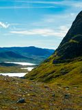 Camping in the mountains of Norway with lakes. Hiking on a mountain top in Jotunheimen, Norway. With view of lakes and mountains Stock Photos